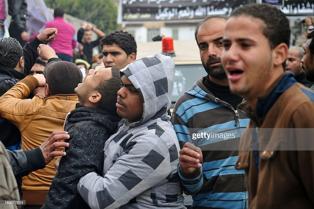 People mourn during the funeral of three people killed in overnight clashes with police on March 4, 2013 in the Egyptian canal city of Port Said. Five people, including two policemen, were killed and hundreds were injured in the overnight fighting after authorities decided to move prisoners awaiting a verdict over alleged involvement in a deadly football riot last year.