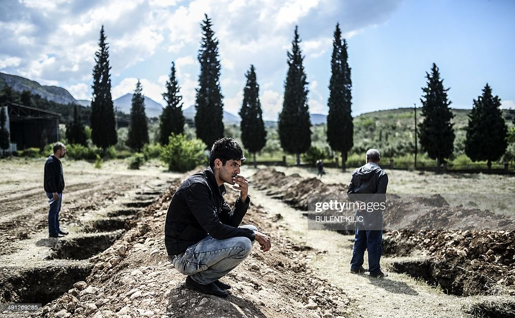 People mourn in a graveyard on May 16 2014 in the western town of Soma after an explosion and a fire in a coal mine killed at least 284 workers three...