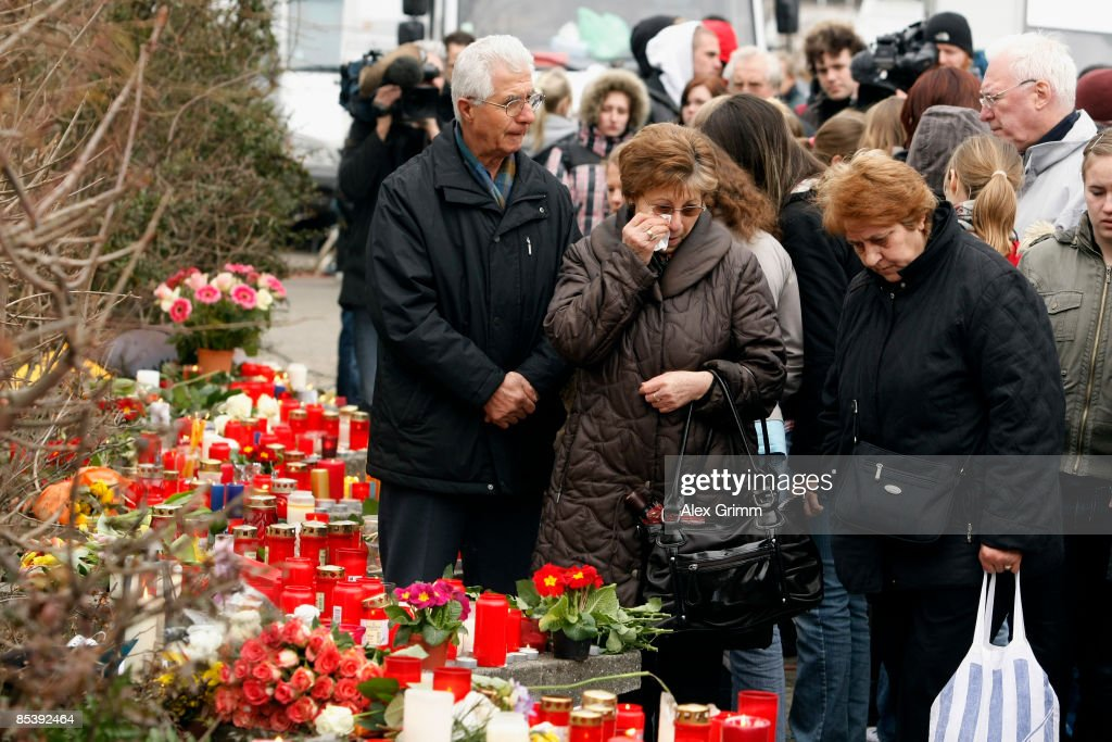 People mourn in front of the AlbertvilleSchool Centre on March 12 2009 in Winnenden near Stuttgart Germany 17 year old Tim Kretschmer opened fire...