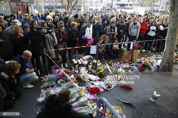 People mourn in front of the cafe 'Bonne biere' in Paris on November 15 following a series of coordinated attacks in and around Paris on November 13...