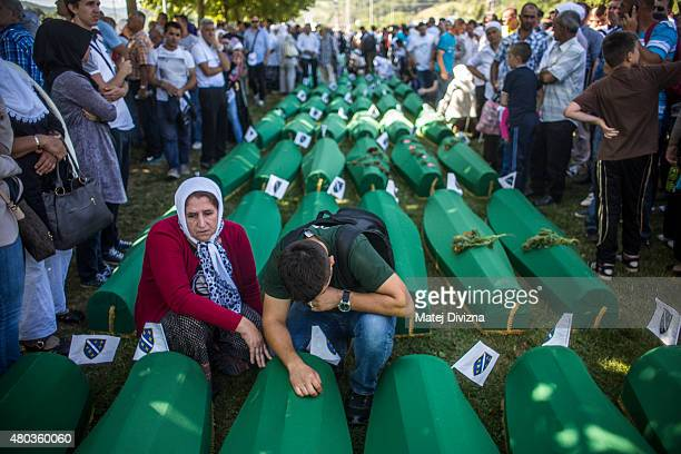 People mourn over the coffin before the mass funeral for 136 newlyidentified victims of the 1995 Srebrenica massacre attended by tens of thousands of...
