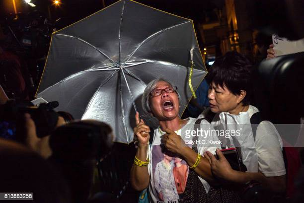 People mourn the death of jailed Chinese Nobel Peace laureate Liu Xiaobo during a demonstration outside the Chinese liaison office on July 13 2017 in...