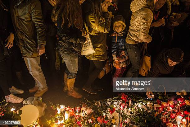 People mourn the victims of Airbus A321 crash at the Palace Square on November 1 2015 in St Petersburg Russia A Russian Airbus321 aircraft with 224...