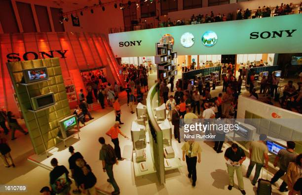 People move around the 'Sony' display booths August 25 2001 on the opening day of the International Broadcast Expo in Berlin Germany The Broadcast...