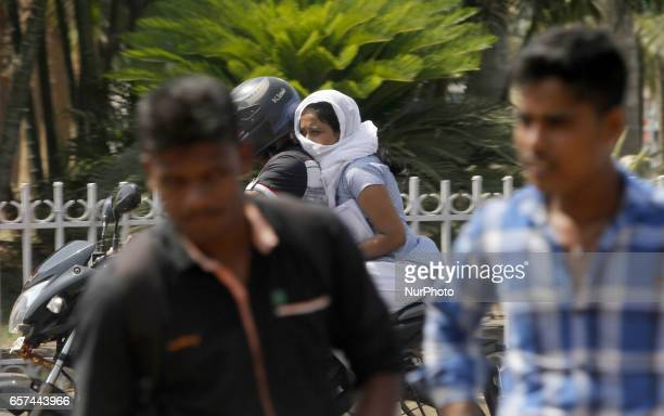 People moves on road covering their face in cloth to protect from the heat wave in todays hot afternoon in the eastern Indian city Bhubaneswar on...