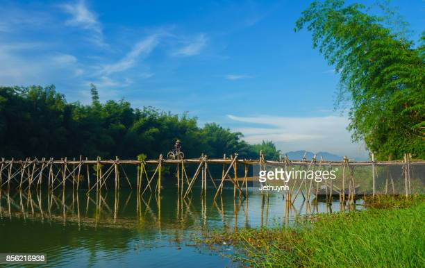 People moving at Bamboo bridge at countryside Quang Ngai Vietnam in the morning
