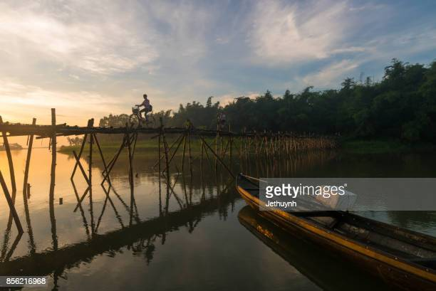 People moving at Bamboo bridge at countryside Quang Ngai Vietnam in the early morning