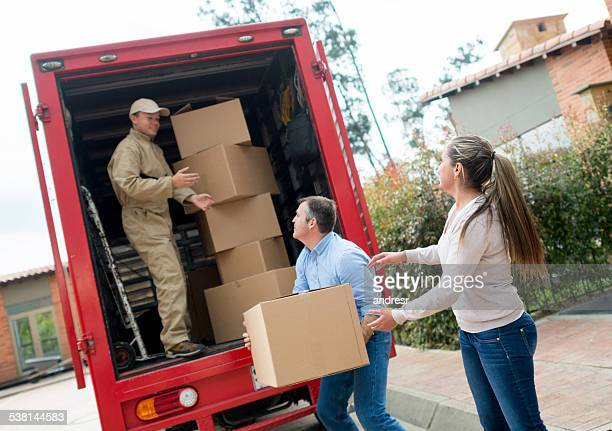 People moving house and loading van