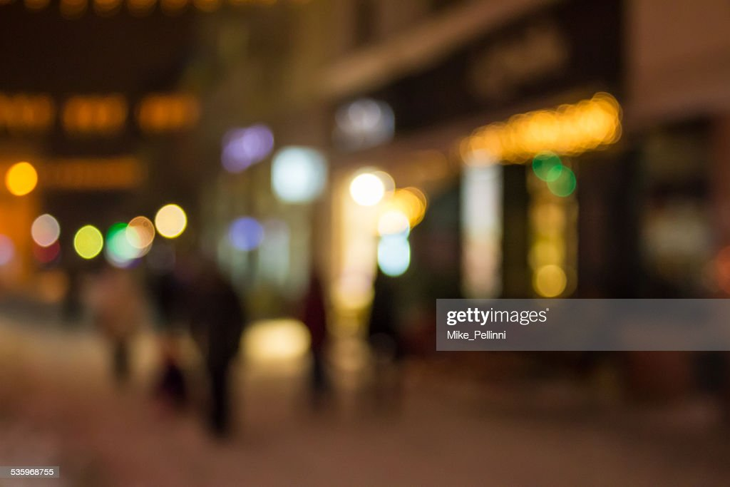 people moving on old city winter night street blurred : Stock Photo