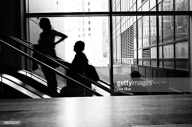 People Moving Up on Escalator, NYC. Black And White.
