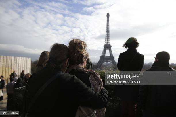 People observe a minute of silence at the Place de Trocadero in Paris on November 16 2015 to pay tribute to victims of the attacks claimed by Islamic...
