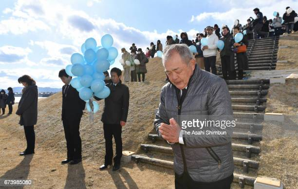 People observe a minute of silence for the victims on the sixth anniversary of the Great East Japan Earthquake and following tsunami on March 11 2017...