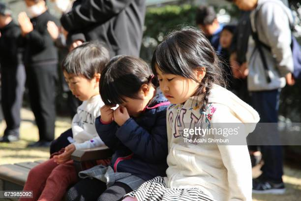People observe a minute of silence for the victims on the sixth anniversary of the Great East Japan Earthquake and following tsunami at Shinonome...
