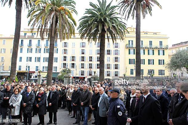 People observe a minute of silence in Ajaccio in the southeastern Corsica prefecture in the French Mediterranean island of Corsica on January 8 as...