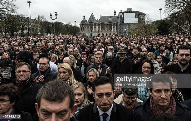 People observe a minute of silence in tribute to the victims of the attacks in Paris on November 16 2015 in Lille northem France Islamic State...