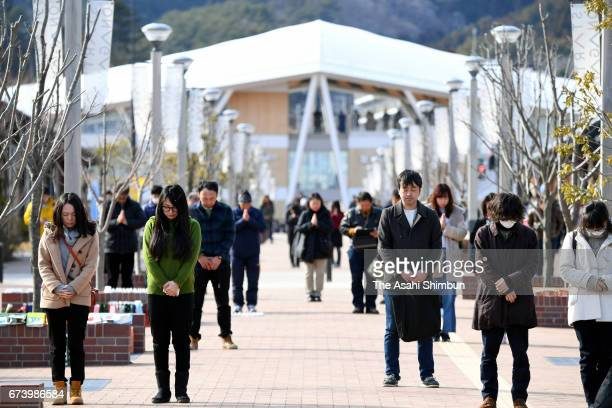 People observe a minute of silence on 1446 on the sixth anniversary of the Great East Japan Earthquake and following tsunami at Seapal Pia Onagawa on...