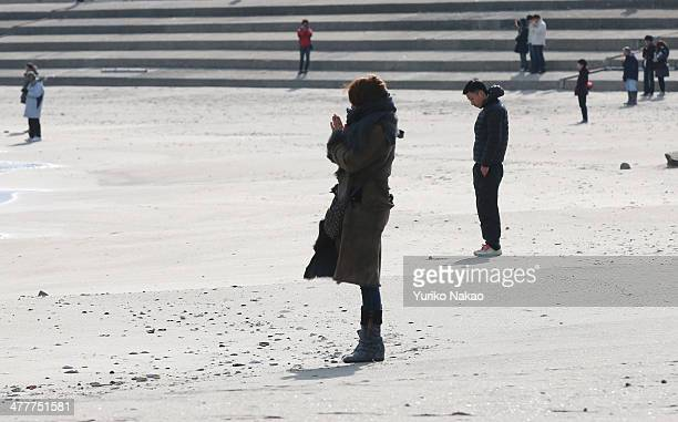 People observe a moment of silence at 246 pm the time at which the magnitude 90 earthquake struck at Shobuta beach on March 11 2014 in Shichigahama...