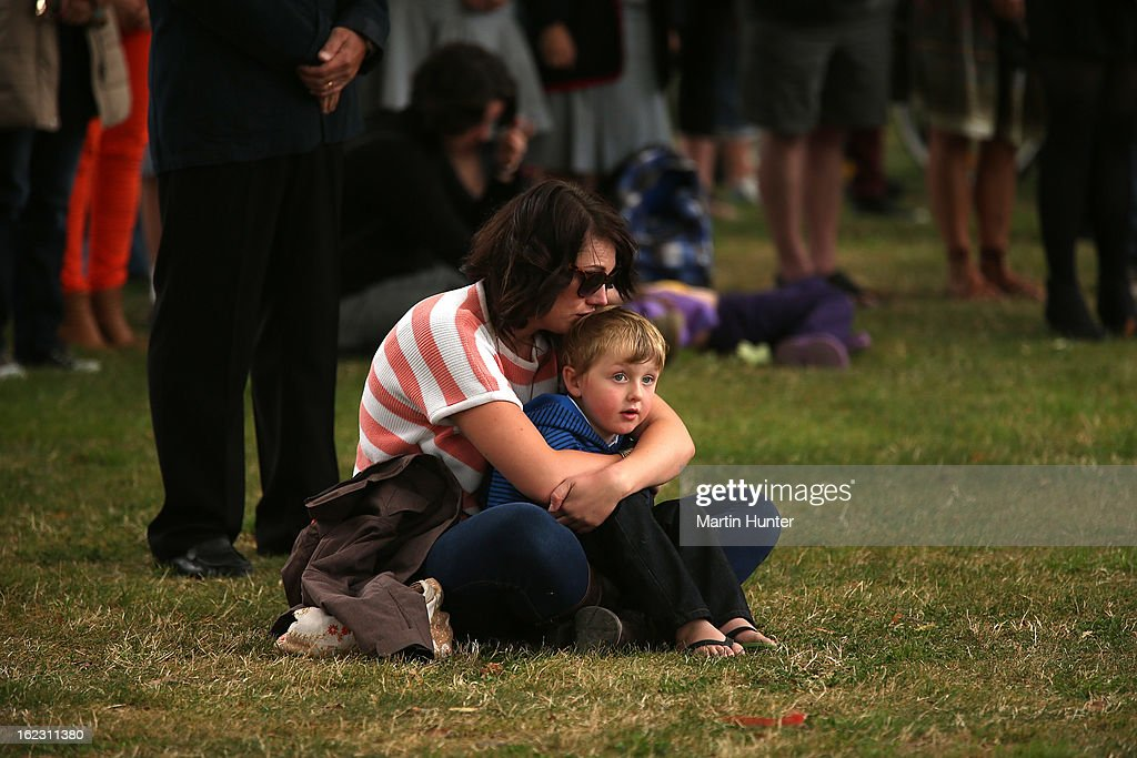 People observe a moment of silence during the memorial service marking the second anniversary of the Christchurch Earthquakes on February 22, 2013 in Christchurch, New Zealand. On February 22, 2011, a 6.3 magnitude earthquake hit Christchurch which, along with several aftershocks, killed 185 people.