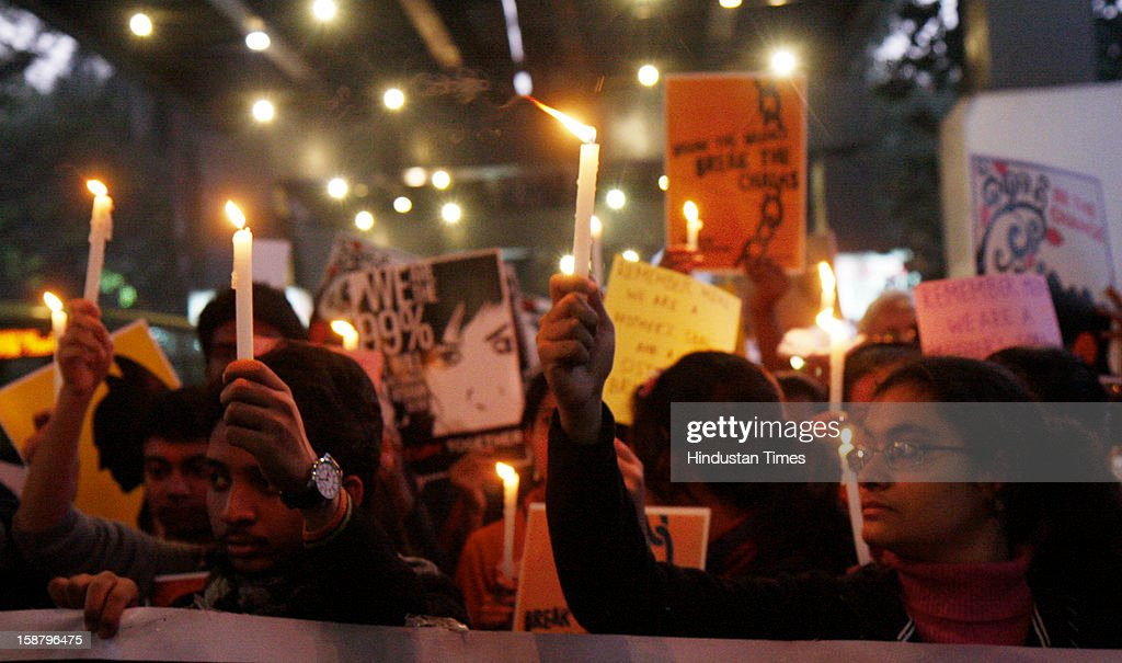 People observe Candle Light march to mourn the death of Delhi rape victim, on December 29, 2012 in Kolkata, India. The girl died of injuries in Singapore hospital after brutally gang raped in a moving bus on December 16, in Delhi.