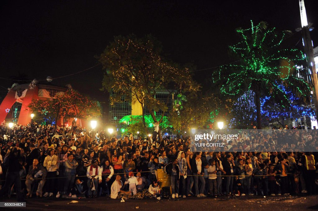 People observe floats during the Light Festival Parade to start Christmas celebrations in San Jose, on December 11,2010. The festival, is promoted by the municipality. AFP PHOTO/ Yuri CORTEZ /