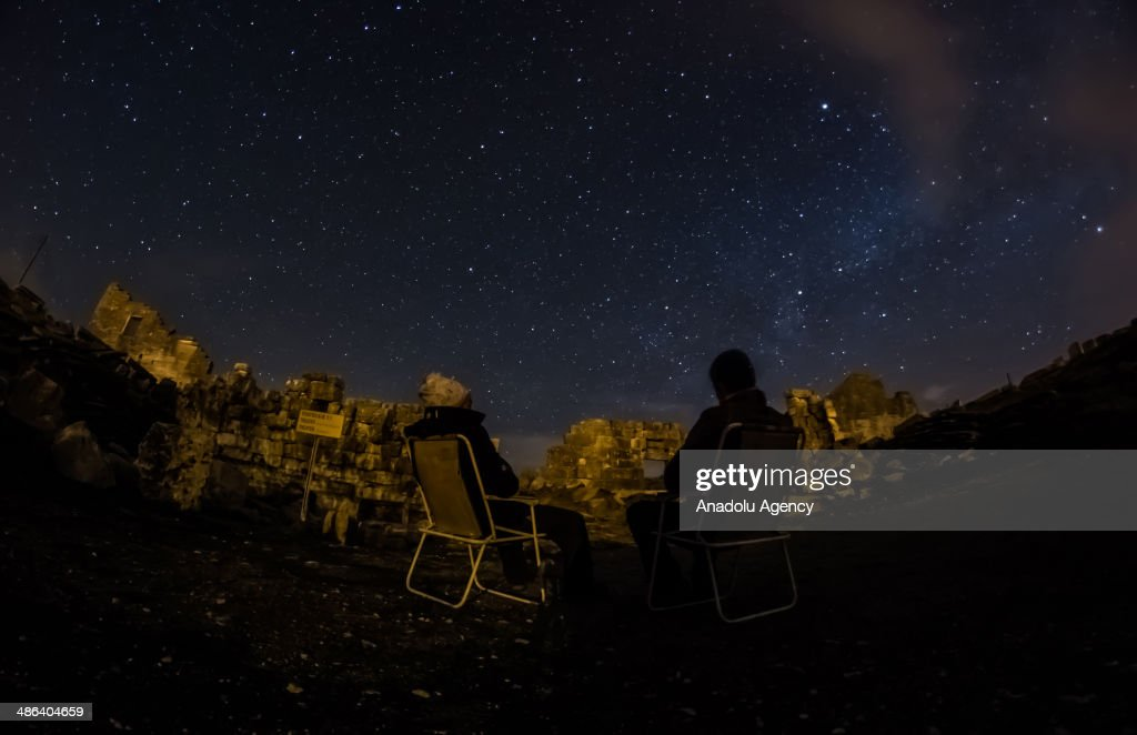 People observe the April Lyrids, a meteor shower lasting from April 16 to April 26 each year, in the ancient city of Aizanoi, in Kutahya, Turkey on April 23, 2014. Aizanoi is an ancient city in western Anatolia in Cavdarhisar, Kütahya. The city has a temple built for Zeus which is the best-preserved temple in all of Anatolia, and also has a large theatre, a stadium adjacent to theatre, two Turkish-style baths, a gymnasium, five bridges on Kocacay which are still used today, an old dam, a trading building, and avenues with columns on both sides, necropolis areas and the sacred cave of Metre Steune.