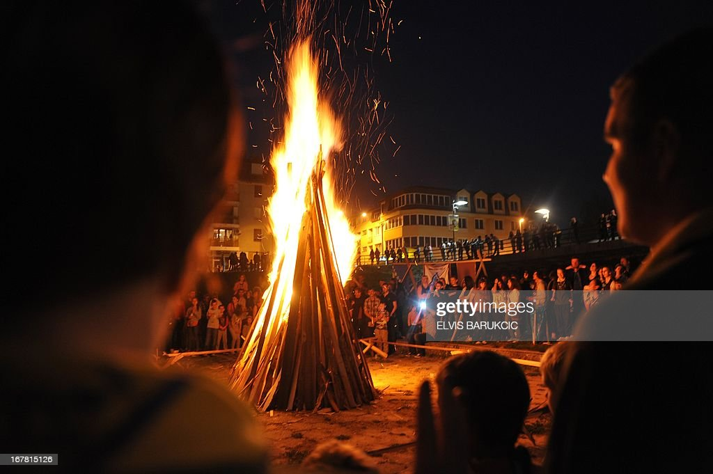 People observe the traditional May 1st camp fire, made in Sarajevo's western suburb of Ilidza, late on April 30, 2013, marking the beginning of celebrations of The International Labour Day. AFP PHOTO / ELVIS BARUKCIC