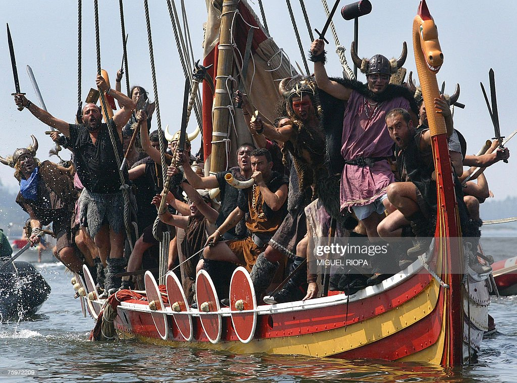 People of Catoira village, in Galicia, northwestern Spain 05 August 2007 simulate the assault of Scandinavian warriors, in viking garb with a replica viking ship on the coast of Galicia 1000 years ago.