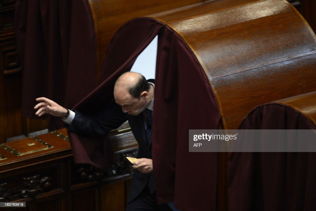 People of Freedom party Angelino Alfano arrives to cast his ballot during the first session of Italian lower-house on March 15, 2013 in Rome. General election in Italy took place on February 26 but as a majority in both chambers of parliament is required to form a government, Italy is left in a state of limbo with a hung parliament that is unprecedented in its post-war history.