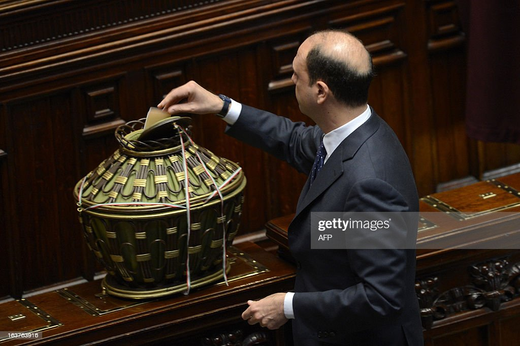 People of Freedom party Angelino Alfano casts his ballot during the first session of Italian lower-house on March 15, 2013 in Rome. General election in Italy took place on February 26 but as a majority in both chambers of parliament is required to form a government, Italy is left in a state of limbo with a hung parliament that is unprecedented in its post-war history.