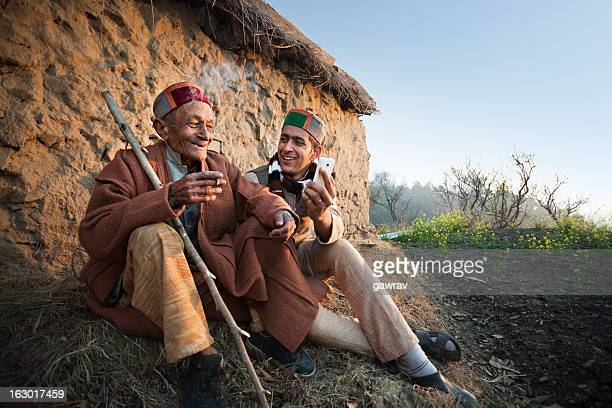 People of Himachal Pradesh: Young man showing phone to grandfather