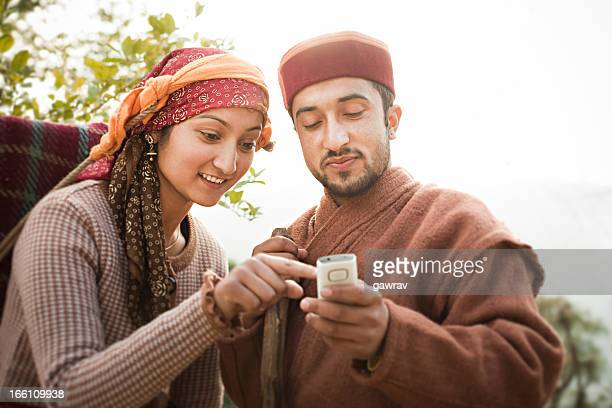 People of Himachal Pradesh: young women and man using phone