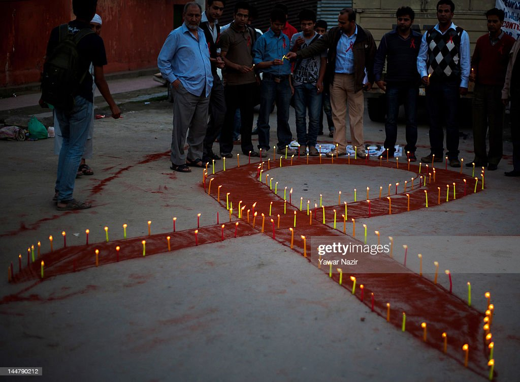 People of Kashmir take part in a candlelight vigil on May 19, 2012 in Srinagar, the summer capital of Indian Administered Kashmir, India. A candle light vigil was organized to commemorate the International AIDS Candlelight Memorial Day for HIV awareness.