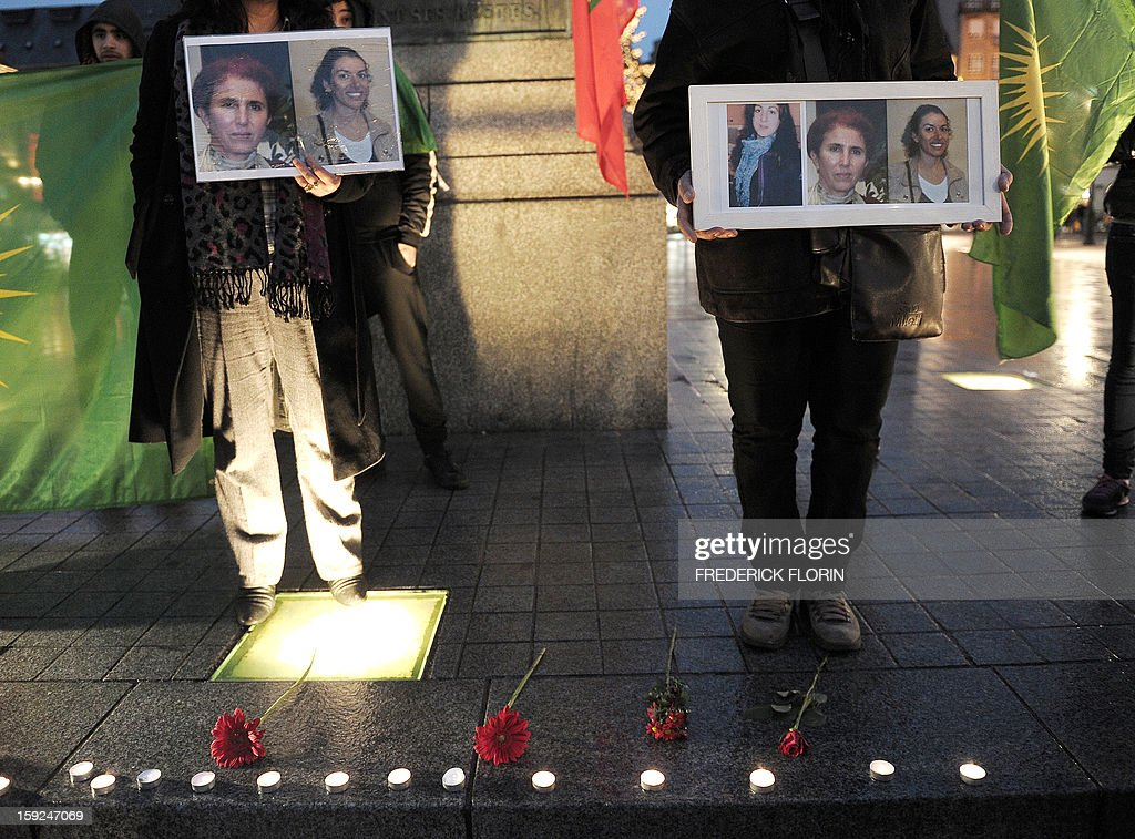 People of Kurdish origin hold photos of three Kurdish women activists, Sakine Cansiz, Fidan Dogan, Leyla Soylemez, killed yesterday in Paris during a demonstration on January 10, 2013, in Strasbourg, eastern France. A co-founder of the Kurdistan Workers' Party (PKK) and two other militants were found shot dead on January 10 in Paris, a day after Turkey and the jailed leader of the banned group were reported to have agreed on a peace plan to end a three-decade-old insurgency.