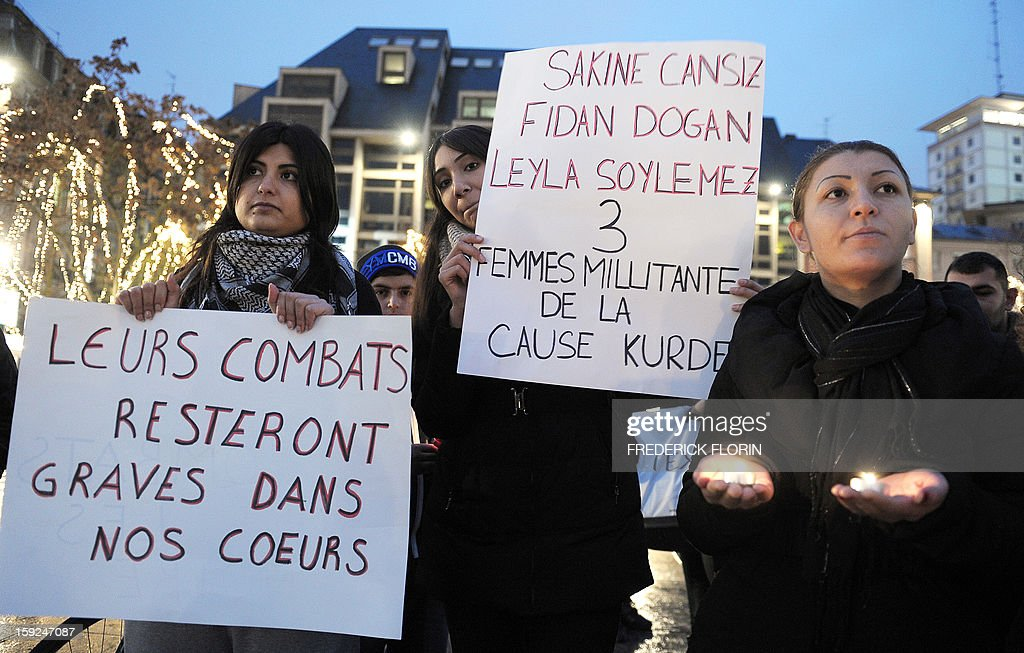 People of Kurdish origin hold signs reading 'Their struggle will stay engraved in our heart' and 'Sakine Cansiz, Fidan Dogan, Leyla Soylemez - 3 women militants of the Kurdish cause' during a demonstration and commemoration in honor of the three Kurdish women activists killed yesterday in Paris on January 10, 2013, in Strasbourg, eastern France. A co-founder of the Kurdistan Workers' Party (PKK) and two other militants were found shot dead on January 10 in Paris, a day after Turkey and the jailed leader of the banned group were reported to have agreed on a peace plan to end a three-decade-old insurgency.