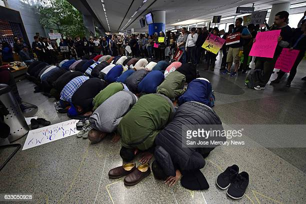 People of the Muslim faith pray near the international arrival gates on Sunday Jan 29 2017 while attending a protest at San Francisco International...