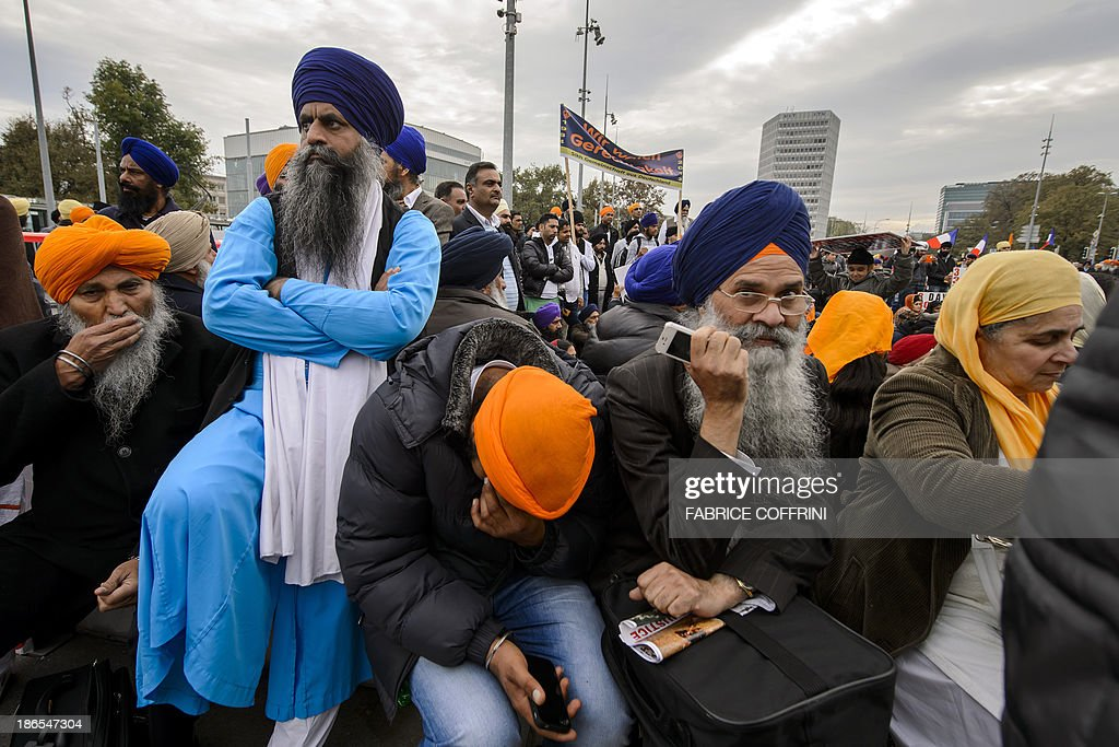 People of the Sikh community stage a demonstration on November 1, 2013 next to the United Nations office in Geneva. Thousands of Sikhs from across Europe rallied outside the UN's Geneva base on November 1, as they step up a campaign to get the world body's human rights arm to class as 'genocide' the deadly 1984 wave of violence against their community in India after prime minister Indira Gandhi was assassinated by her Sikh bodyguards.
