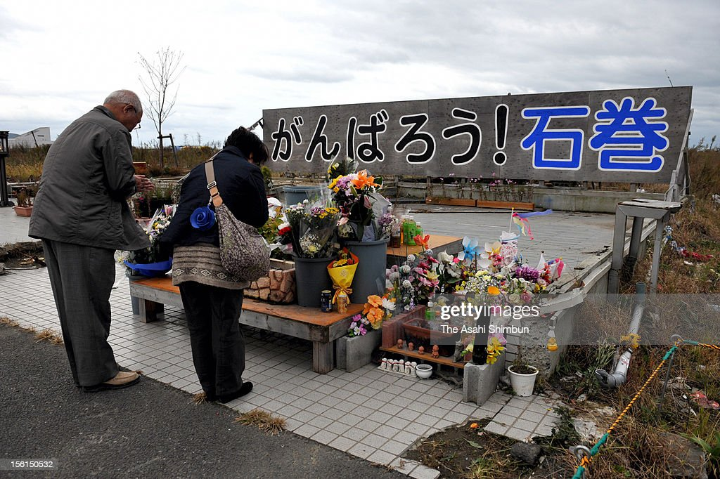 People offer flower bunches to commemorate the victims on November 11, 2012 in Ishinomaki, Miyagi, Japan. Japan marks 20 months anniversary of the Great East Japan earthquake and following tsunami, occurred on March 11, 2011.