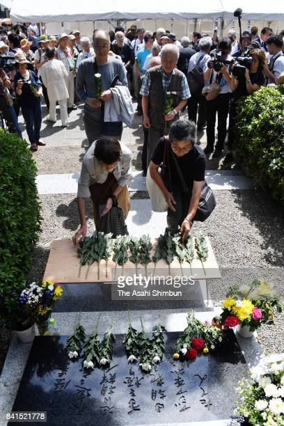 People offer flowers at the memorial for the Korean victims of the Great Kanto Earthquake at Yokoami Park on September 1 2017 in Tokyo Japan National...