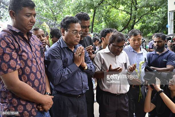 People offer flowers to pay their respects to the victims of the attack on Holey Artisan Bakery in Dhaka Bangladesh July 4 2016 The attack the worst...