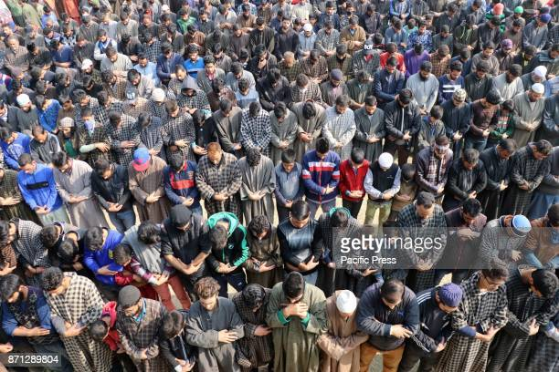 People offering funeral prayers of a local militant Waseem Ahmad on Tuesday November 07 2017 who was killed in an encounter that raged between the...