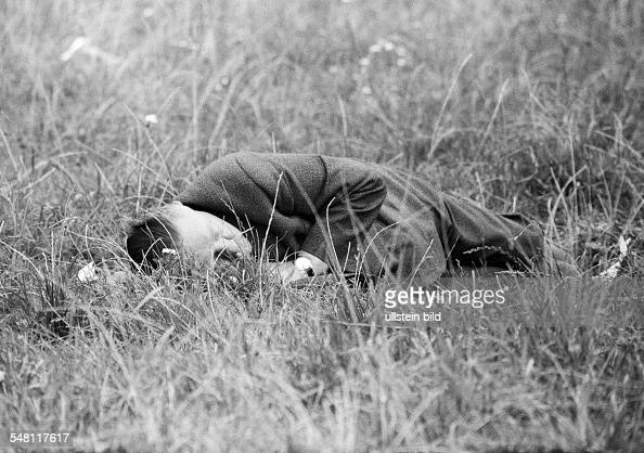 people older man lies on a meadow and sleeps of drunken groggily Munich Beer Festival 1966 aged 50 to 60 years Munich Upper Bavaria Bavaria