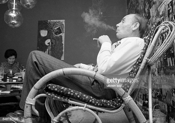 people older man sits in a rockingchair smoking a cigar aged 60 to 70 years Josef