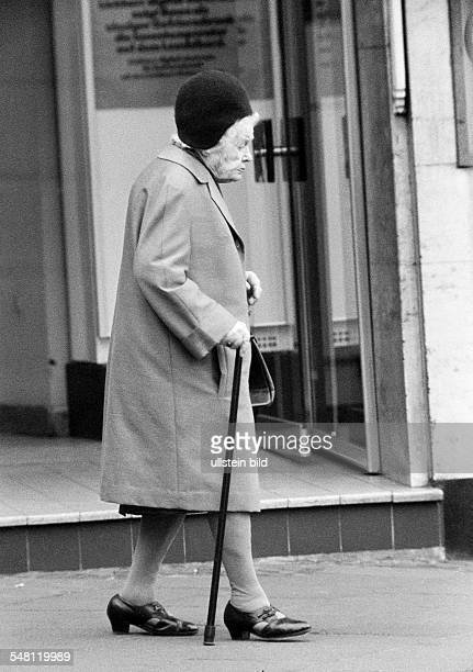 people older people older woman with a walking stick takes a walk aged 70 to 80 years