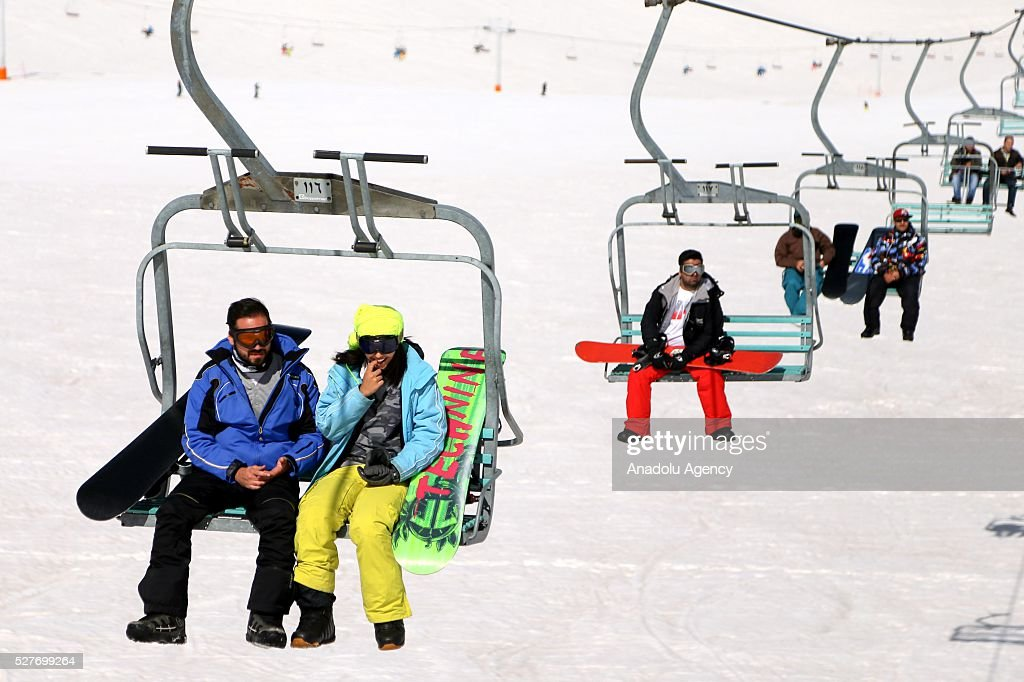 People on a chair-lift at the ski resorts of Alborz mountain during a competition marking the end of the winter at Tochal ski resort north of the capital Tehran, Iran on May 3, 2016.