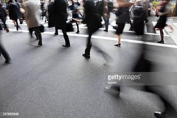 People on a crosswalk with a blur motion effect