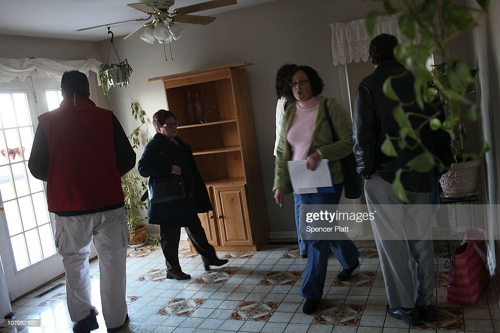 People on a foreclosure tour look at a foreclosed home on November 21, 2010 in Ansonia, Connecticut. The home was one of numerous foreclosed homes on a bus tour organized by realtor Frank Hoinsky. Hoinsky has given over five tours which last for approximately three hours and stop at foreclosed homes in the lower Naugatuck Valley in Connecticut. As the American economy continues to struggle, housing prices are at an all-time low. Currently an estimated 1.65 million homes are in the foreclosure process in America and the Federal Reserve has announced that it expects about 4.25 million more foreclosure filings through 2012.