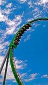 People on a green roller coaster ride.