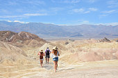 Family hiking in  Death Valley National Park on hiking vacation trip ,eastern California and Nevada, USA.
