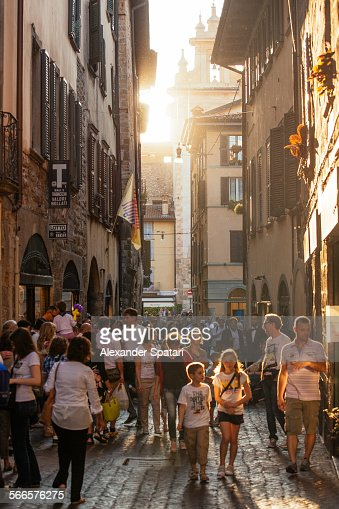People on a shopping street in Bergamo, Italy
