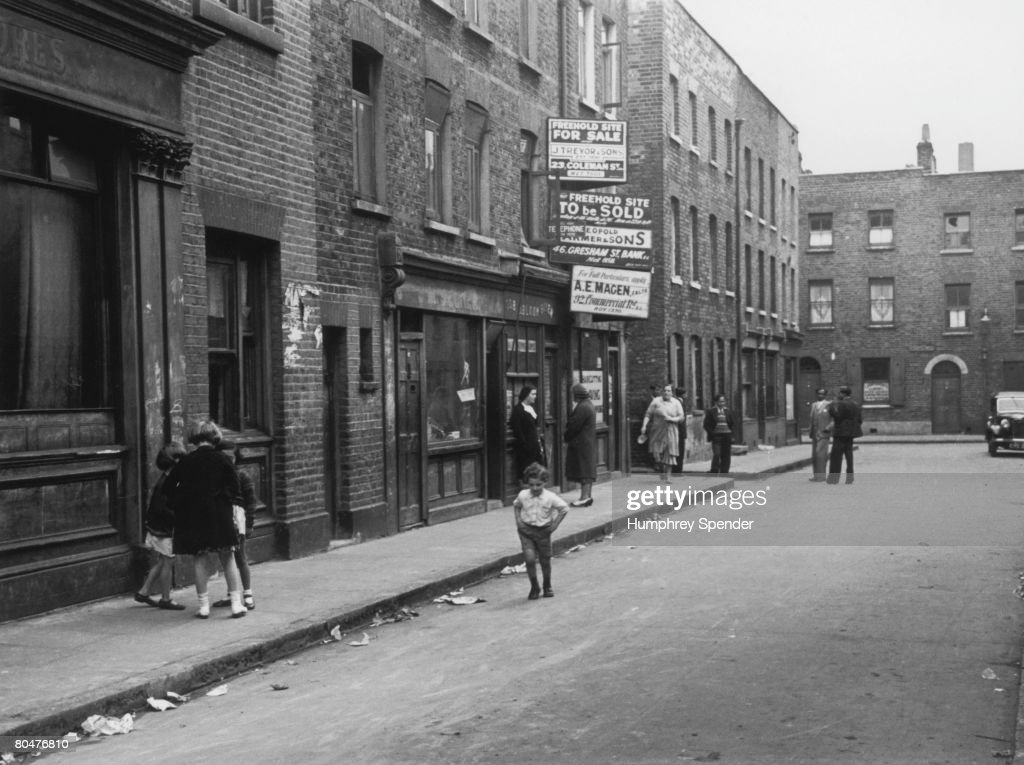 People on a street in Whitechapel in the East End of London October 1938 Original publication Picture Post 27 Whitechapel pub 15th October 1938